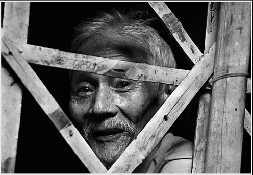 An old man living under the bubog tree. Photo by Jason Matias