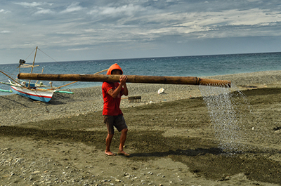 watering the sand