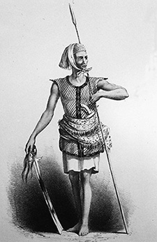 """An """"Iranun"""" sea-warrior attired in the distinctive thick cotton quilted red vest, and armed with a long spear and kampilan, a long heavy """"lanoon sword"""" ornamented with human hair as described in The Global Economy and the Sulu Zone: Connections, Commodities and Culture."""