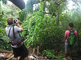 Nick Foster and a friend taking photos of fruit bats.