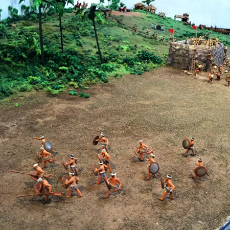 Tausug warriors on the attack towards the Spanish dragoons.