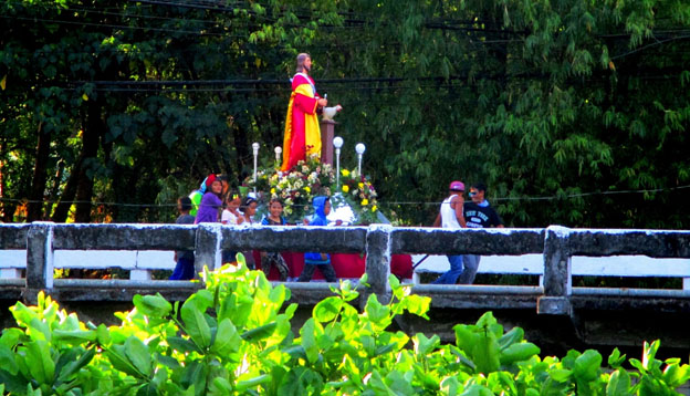 The carriage of San Pedro on its way from Palaca to Miag-ao Church making its way over the Spanish Bridge.